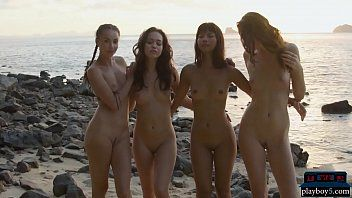 Four nice-looking lesbo girlfriends acquire exposed on the beach